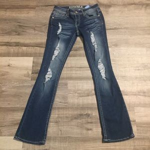 Hydraulic distressed slim bootcut jeans. Size 7/8